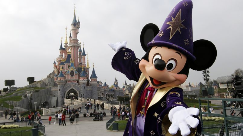 Disney character Mickey poses in front of the Sleeping Beauty Castle at Disneyland park as part of the 20th birthday celebrations of the park, in Chessy, near Marne-la-Vallee, outside Paris, on March 31, 2012. AFP PHOTO / THOMAS SAMSON